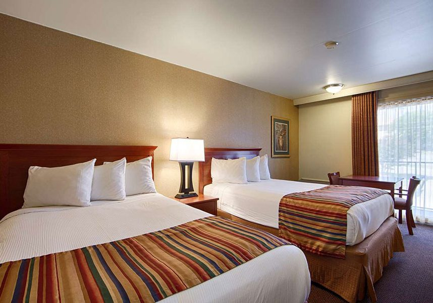 two guest beds in hotel room at Best Western Sherwood Inn
